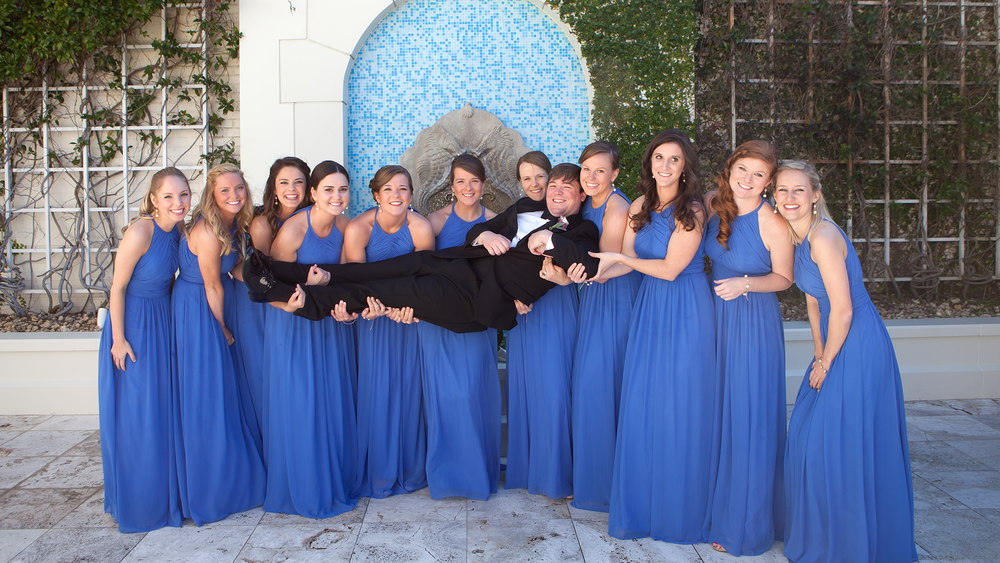Ponte Vedra Beach fL, Groom lifted up by Bridesmaids