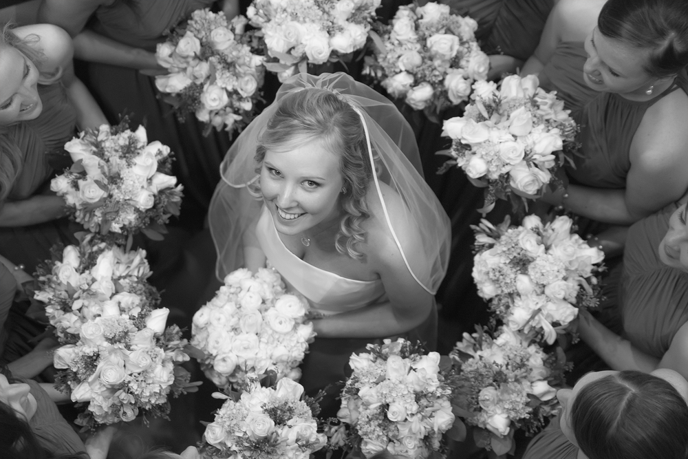 Bride surrounded by flowers and Bridesmaids