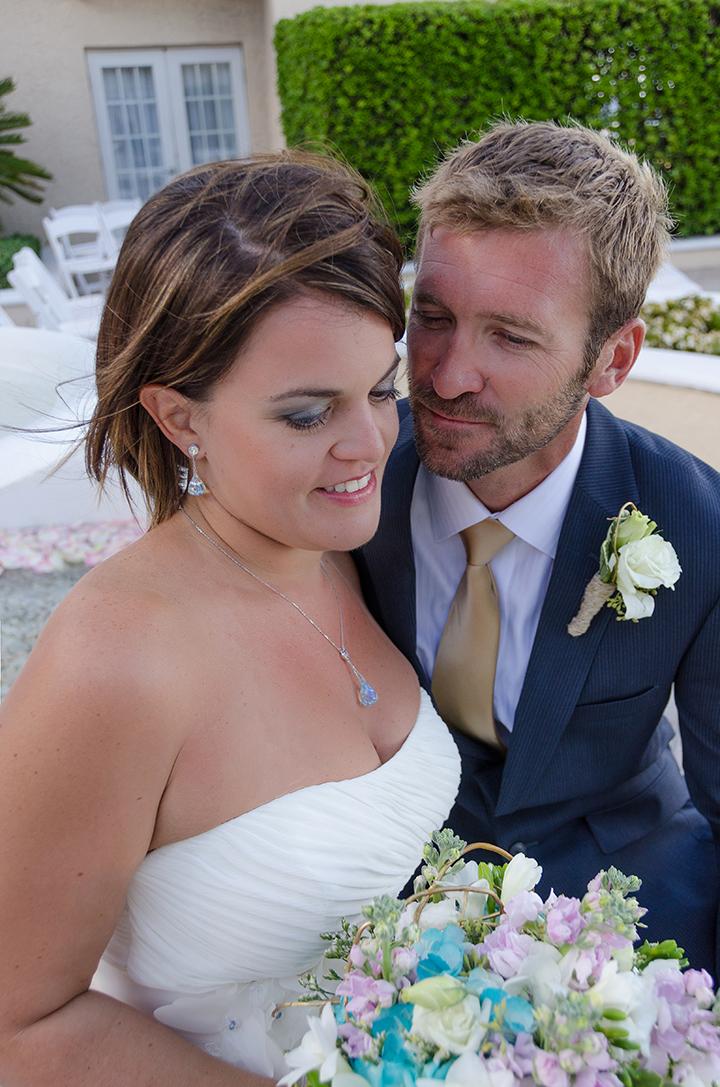 Groom kisses bride in ponte vedra beach florida