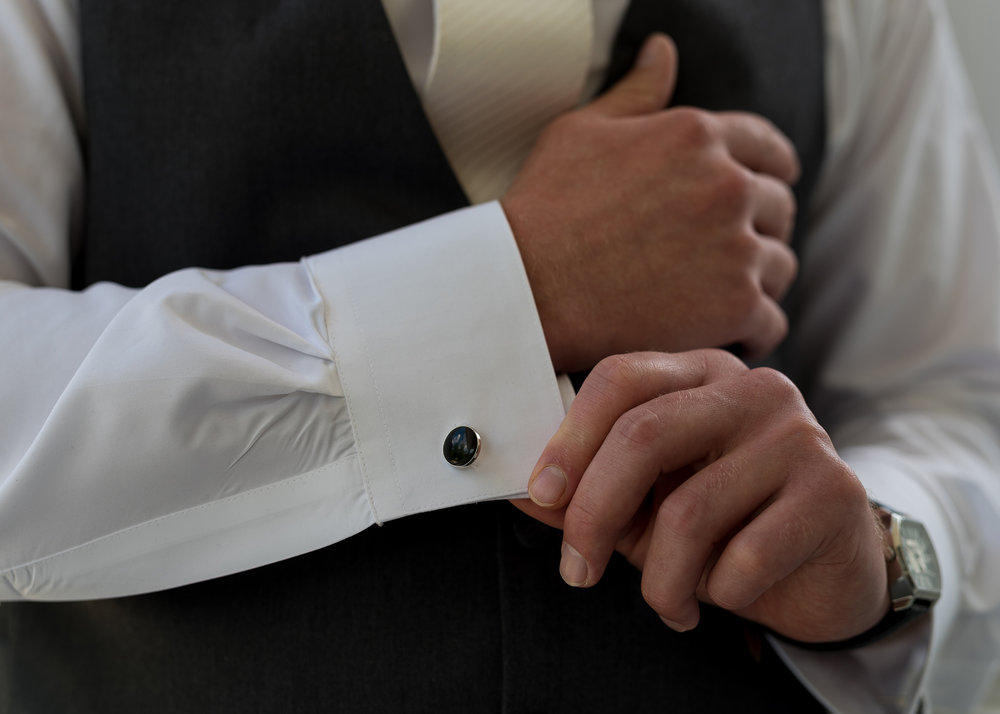 Groom Getting Ready Adjusting Cufflink