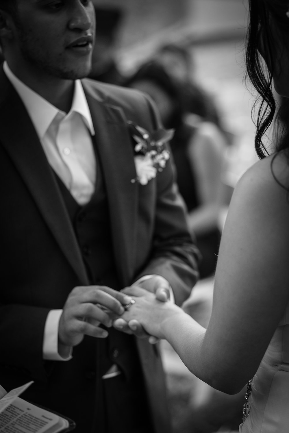 Groom Places Ring on Brides Finger Photo Detail