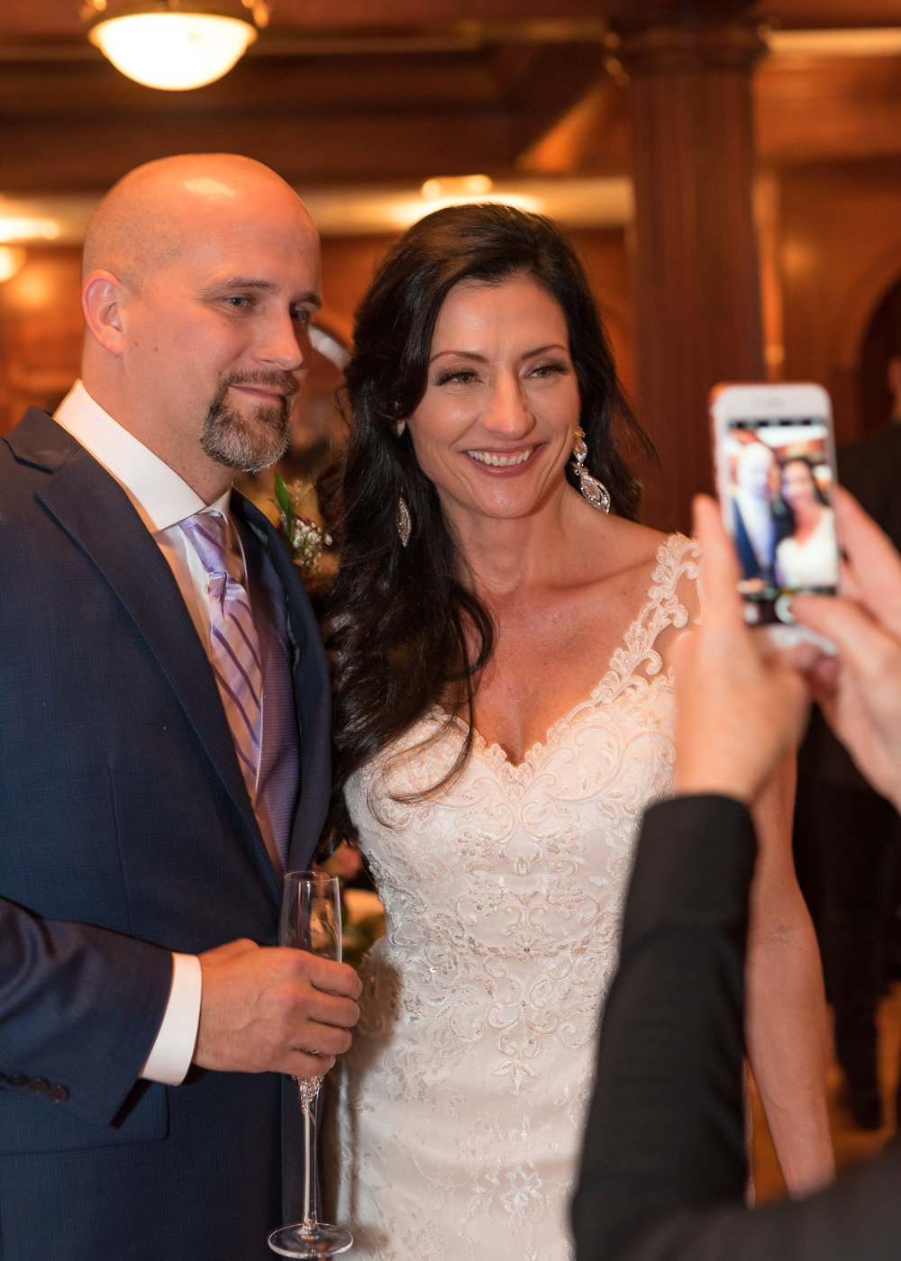 Bride and Groom Pose for Smartphone Photo