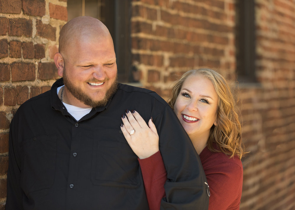 Happy Couple Marietta Square Engagement Photos