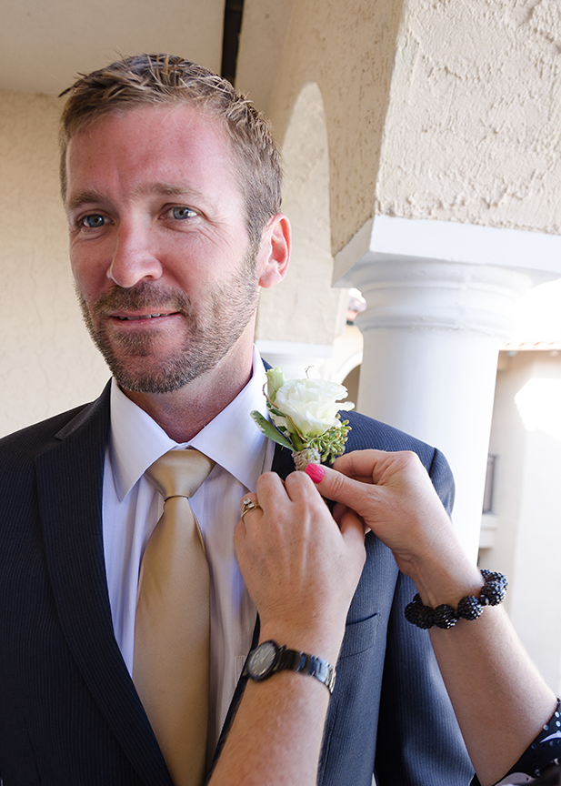 Groom with boutonniere and short haircut