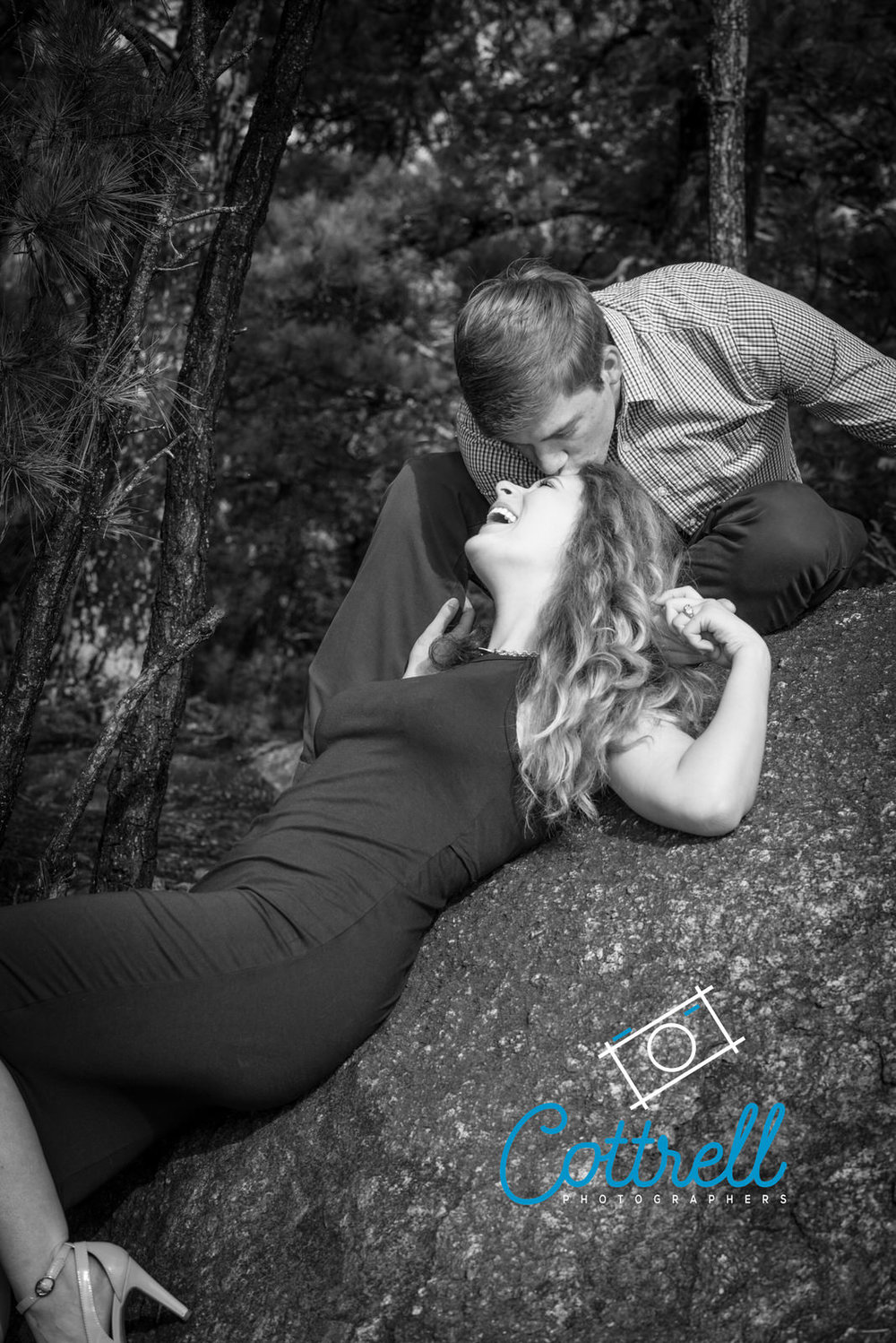 Couple laughing and enjoying a fun engagement photo session near Cartersville Georgia