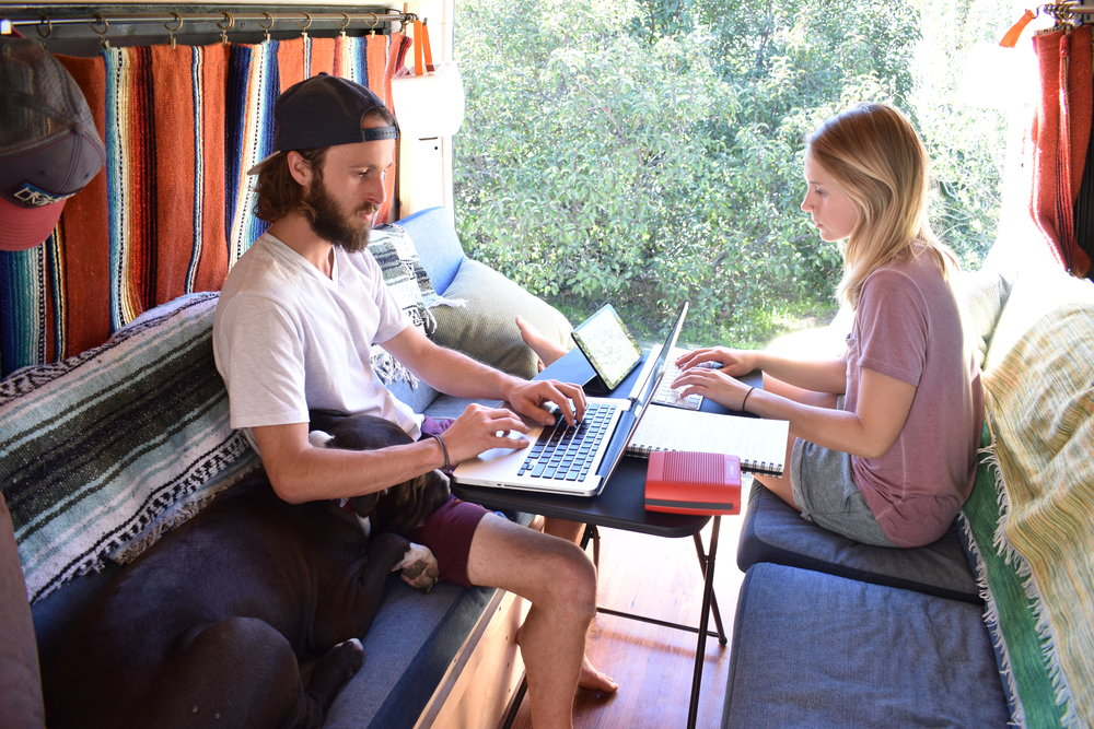 Digital nomads working hard on our van conversion eBook.