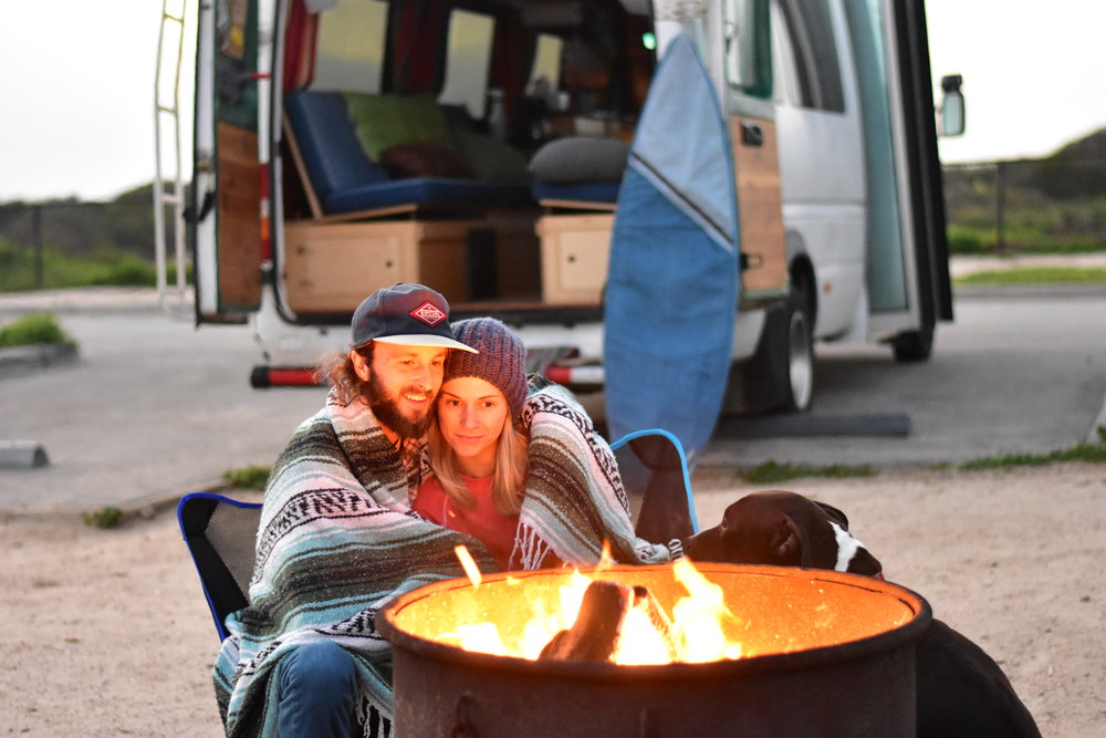 A Vanlife couple having a relationship while traveling in a Sprinter van.