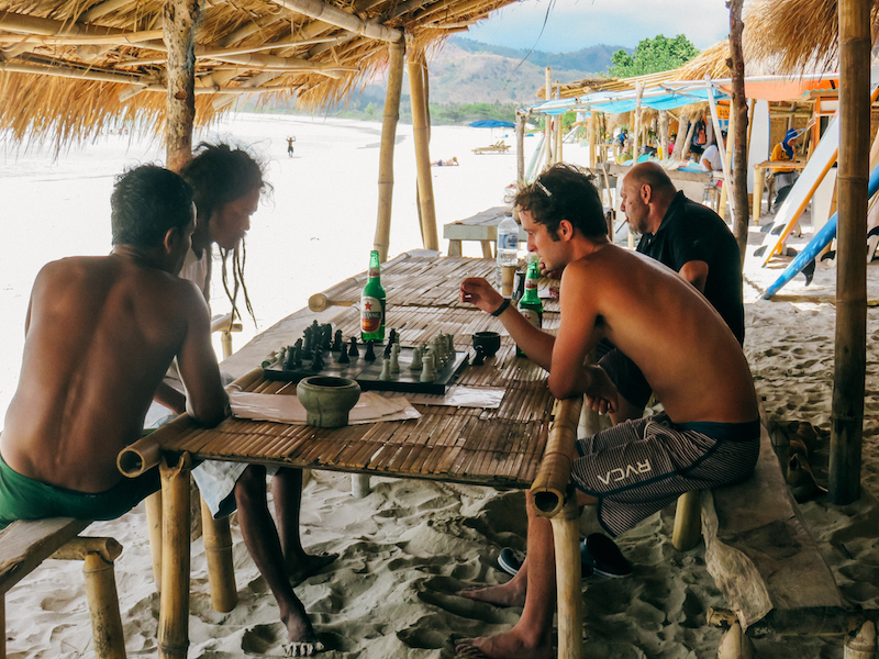Pete losing hard at chess with locals in Nusa Lembongan, Indonesia