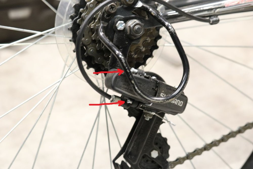 These are the limit screws on your rear derailleur. If they are too loose, they can send the chain into your frame or the derailleur into the wheel.