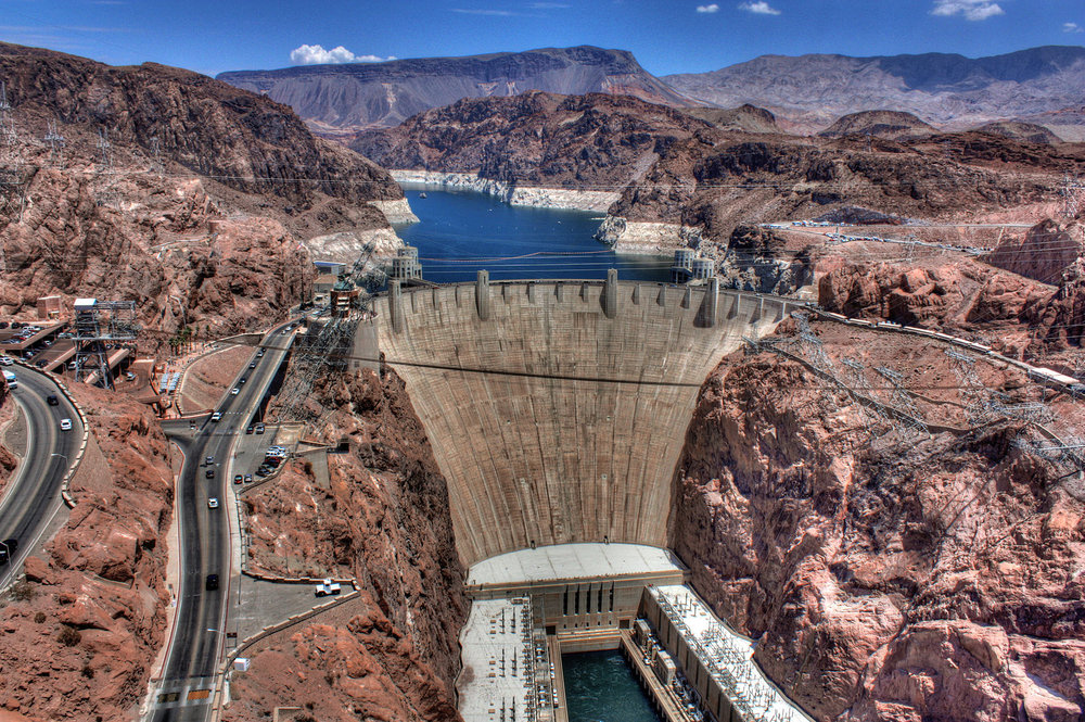 The Hoover Dam, once known as Boulder Dam, is a concrete arch-gravity dam in the Black Canyon of the Colorado River, on the border between the U.S. states of Nevada and Arizona.