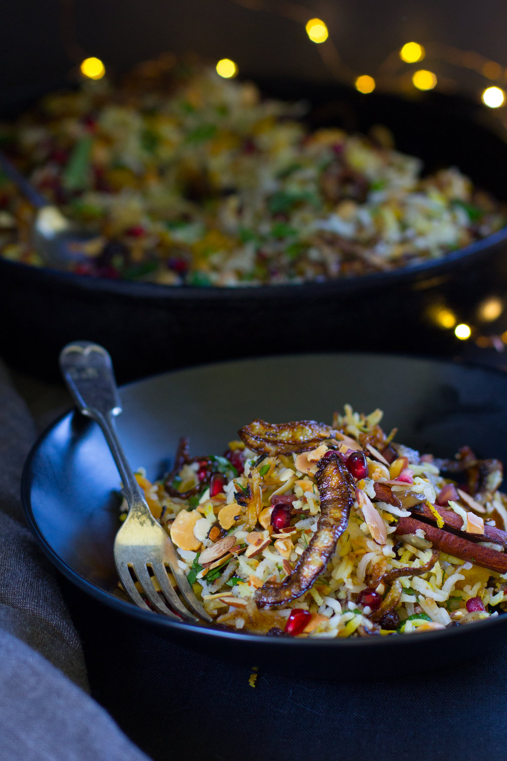 Spiced rice studded with gleaming pomegranate seeds, toasted almonds, dried fruit, fresh mint and orange zest