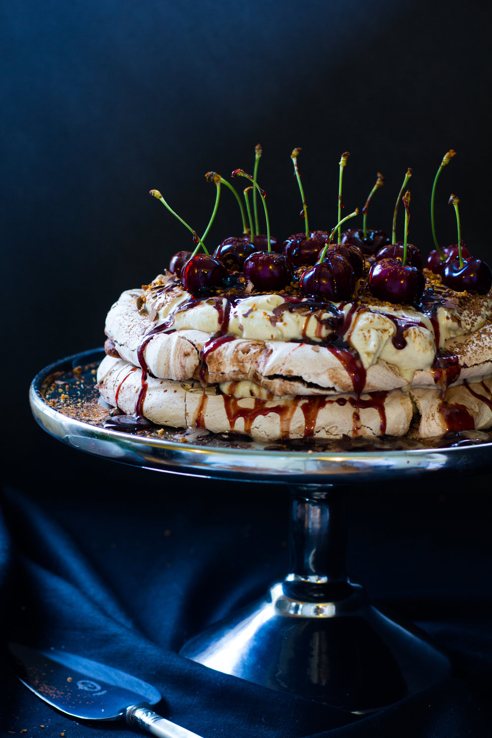 Black forest cherry pavalova - Dark chocolate, coffee, cherries, and a sticky caramel syrup stud this show stopping dessert