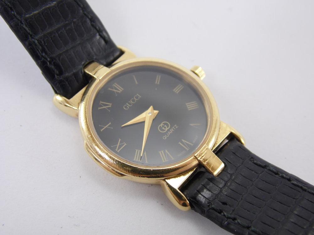 dde6897ac9a Vintage authentic gucci black gold roman numeral womens swiss luxury  designer quartz watch eta JPG 1500x1125