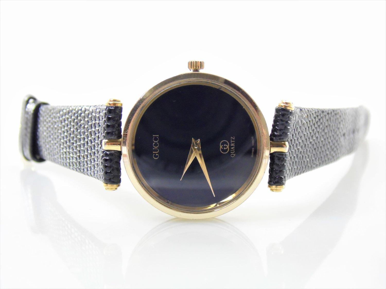 a5e0c99fe1b Vintage Black   Gold Authentic Gucci Logo Mens Womens Unisex Stack Luxury Designer  Swiss Quartz Watch ETA 561.001 Stk 3C — New Avenue