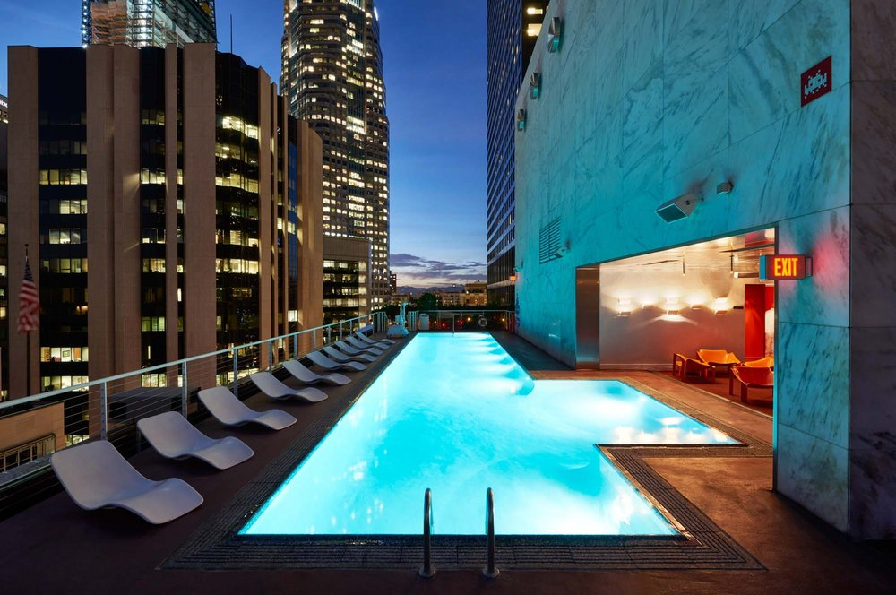 The Rooftop at The Standard, Downtown LA offers stunning, panoramic views of Downtown Los Angeles and the mountains beyond, a heated swimming pool, red AstroTurf deck, dance floor, nightly DJs, bar, outdoor fireplace, waterbed pods, sculptured topiary, and our classic German Biergarten.