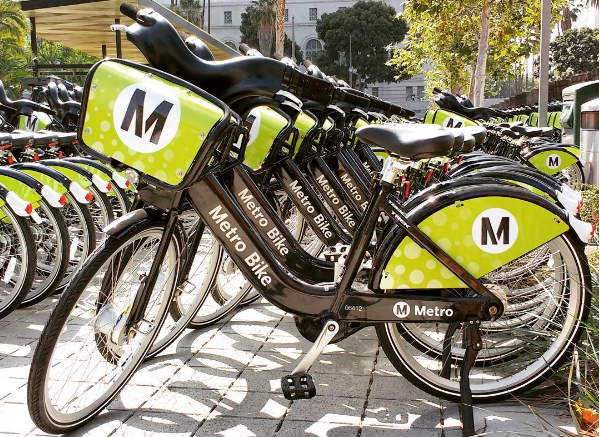 Try DTLA's newest option for transportation,  Metro Bike Share . Metro Bike Share is fast, easy, and fun way to ride, anytime. Get a bike from any Metro Bike Share station, go for a ride, and give it back at any station. Purchase a walk-up trip at any station using your debit or credit card. Stations closest to i3 Arts Festival: Olive and 5th St (Pershing Square), Grand and 3rd St (Grand Performances) and Main and 1st (Grand Park).