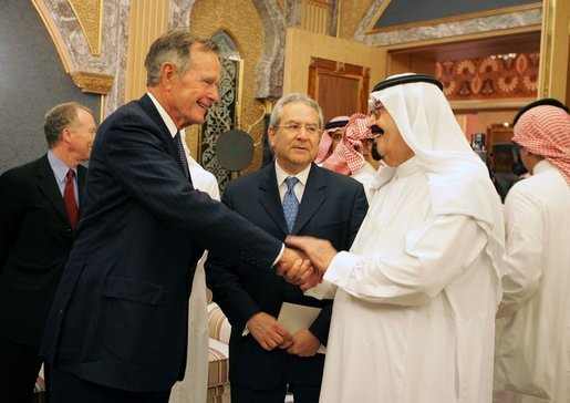 George H. W. Bush shakes hands with newly crowned King Abdullah in Riyadh.
