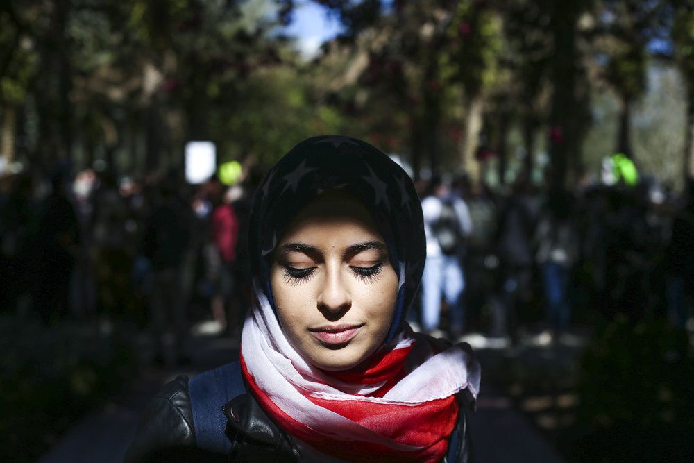 "Sarah Eldin, 19, poses for a portrait at University of Southern Florida in Tampa, Fla. on Monday, January 30, 2017. ""Everyday we're a symbol of what's at hand right now,"" she said for why she chose her specific Hijab design to wear today. ""I want people to feel hope and happiness."" Concerned students and faculty gathered for a No Ban No Wall Tampa Rapid Response protest against the executive order Donald Trump signed on Friday calling for a travel ban on Syrian refugees indefinitely, suspending all refugee immigration for 120 days and blocking citizens of seven majority Muslim countries for 90 days."