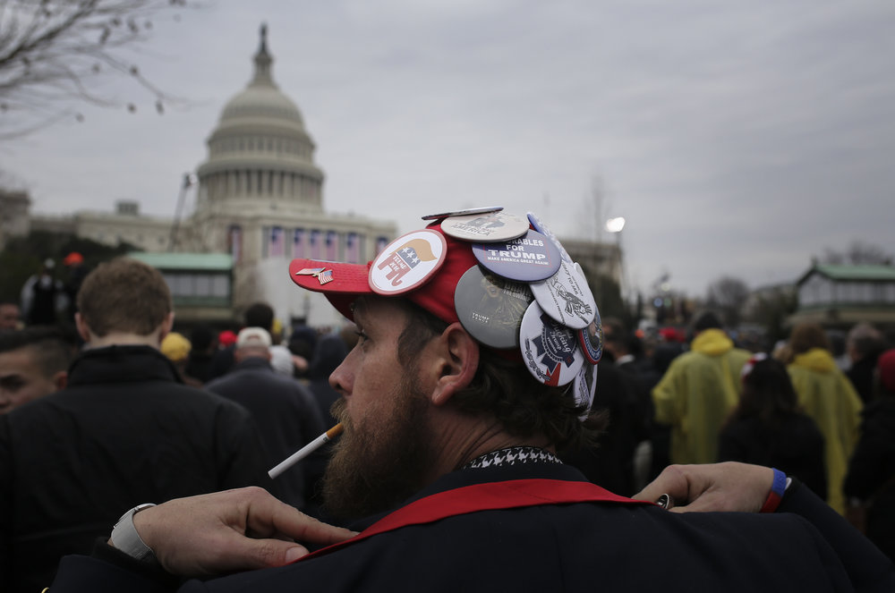 "Matthew Cooper of Toledo, OH. watches the 58th Presidential Inauguration for President Elect Donald Trump at the U.S. Capitol in Washington D.C., Friday, January 20, 2017. Cooper said ""I'm ecstatic. I'm about to start crying here in a minute. I haven't cried since my grandpa died. This is our moment here."" He has been collecting Trump buttons since he went to his first Trump rally in Ohio."
