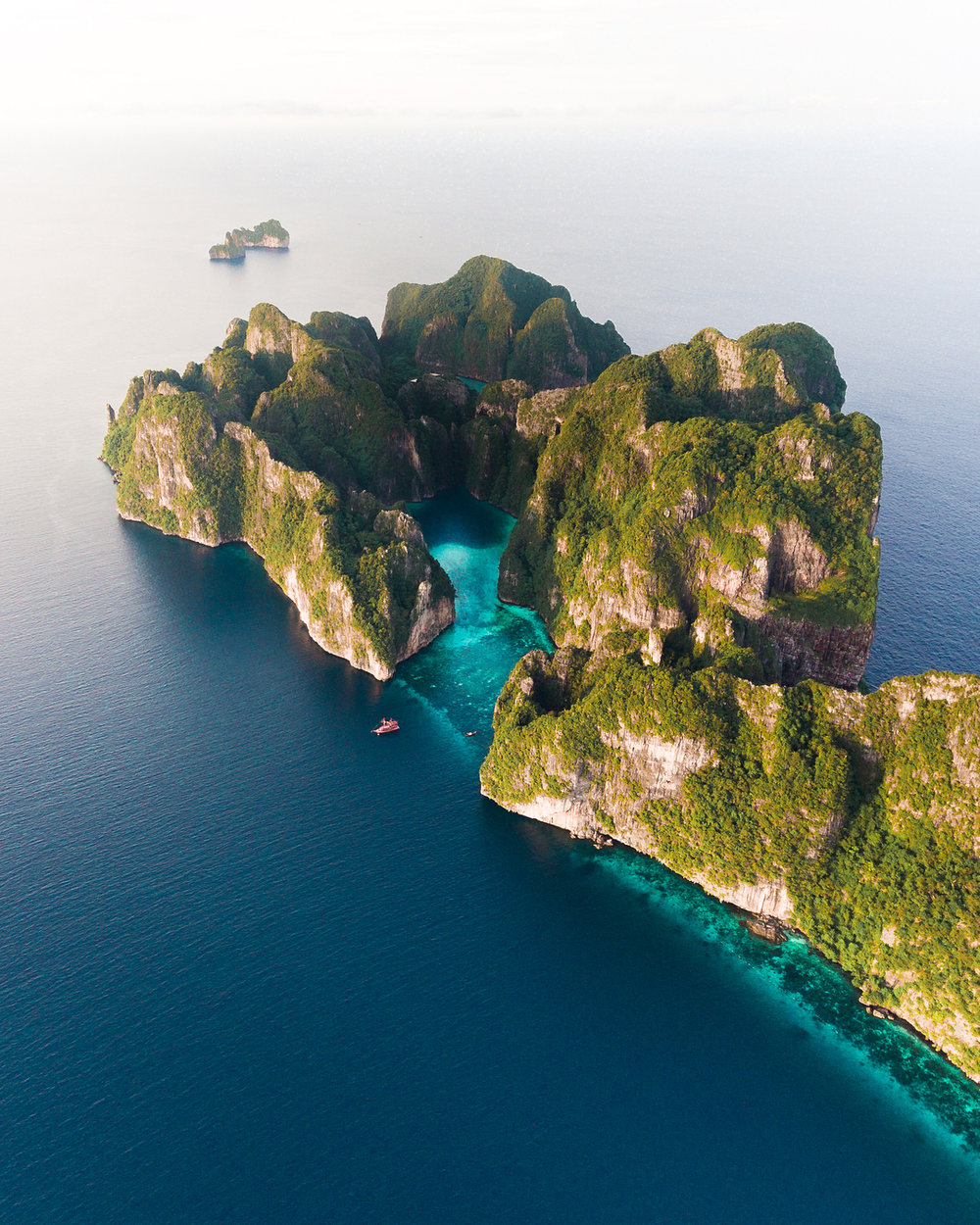 There are 2 Islands in Phi Phi. One is Koh Phi Phi Don and the other is Koh Phi Phi Leh. The good shots are mostly on Koh Phi Phi Leh and you need to travel there by a 30 minute boat ride.  Photography by @joshuafooo