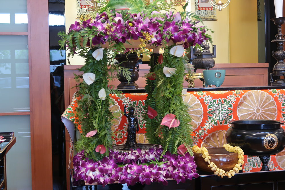 The  hanamido , or flower shrine, and the baby Buddha. Members poured sweet tea on the baby Buddha.