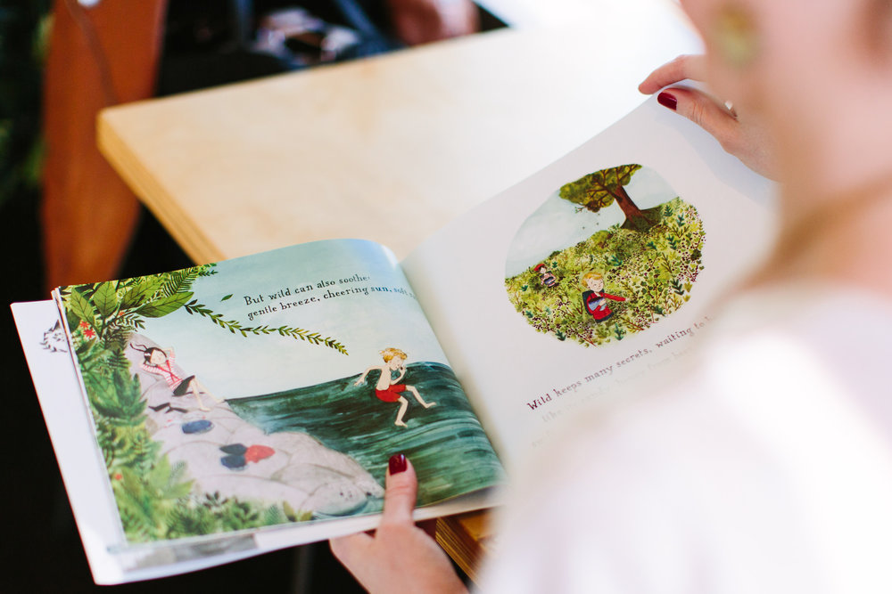 The storybook in this image is Finding Wild, with illustrations by Abigail Halpin.