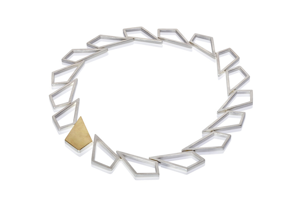 Silver Chevron necklace with gold clasp.jpg