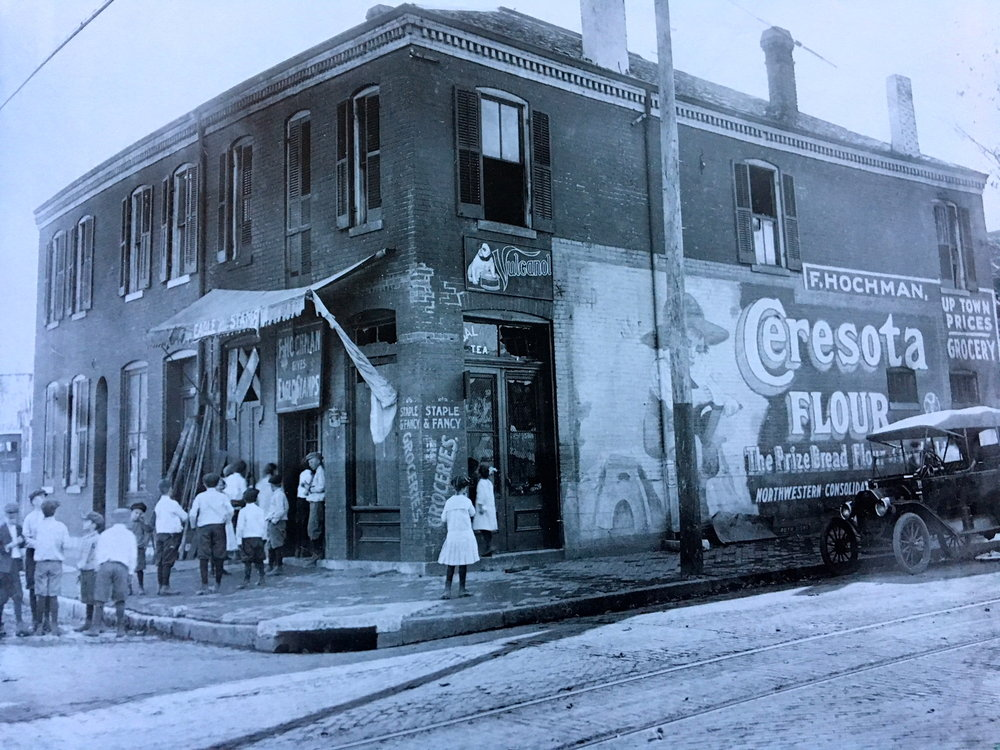 Northwest corner of Michigan Ave and Courtois St. outside of F. Hochman Grocery Store in Carondelet Neighborhood, ca. 1900