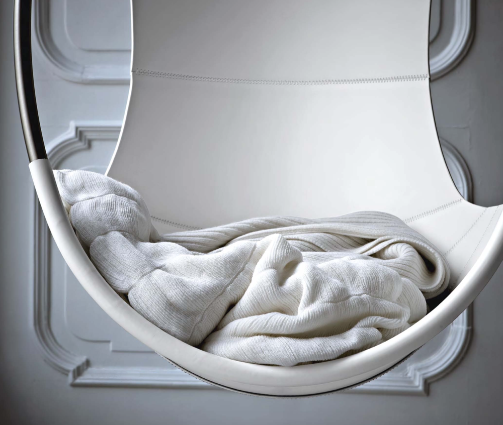 Flair and Ron Blankets in Swing Chair  - Inquire