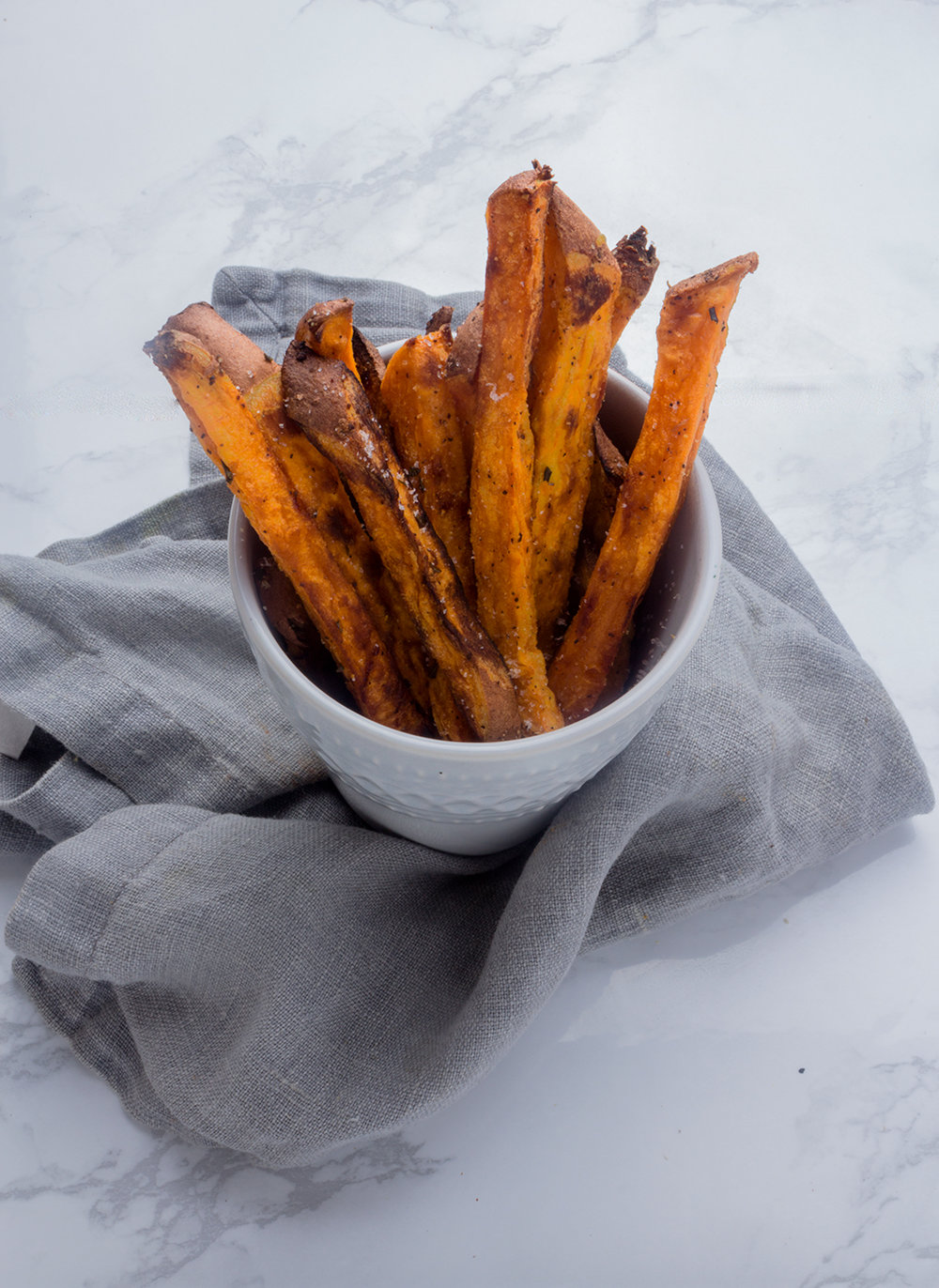 Crispy fries without frying? You bet with these Rosemary Maple Sweet Potato Fries.