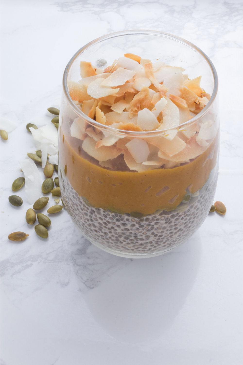 "Layers of chia pudding, pumpkin pie ""filling"", toasted pepitas and coconut."