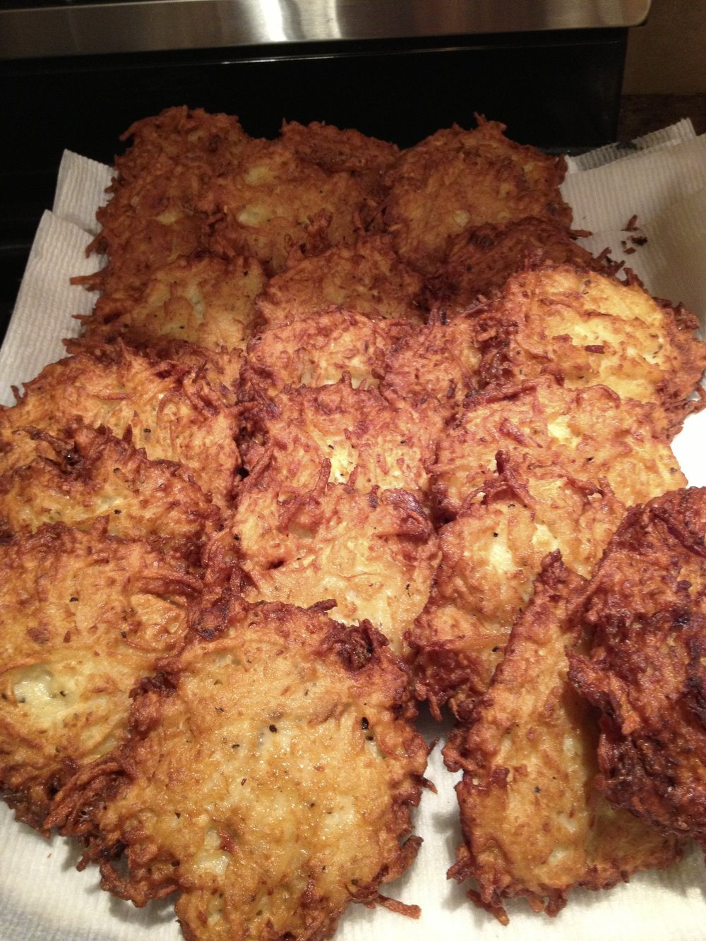 Crispy potato latkes are basically large (and tastier) hash browns.