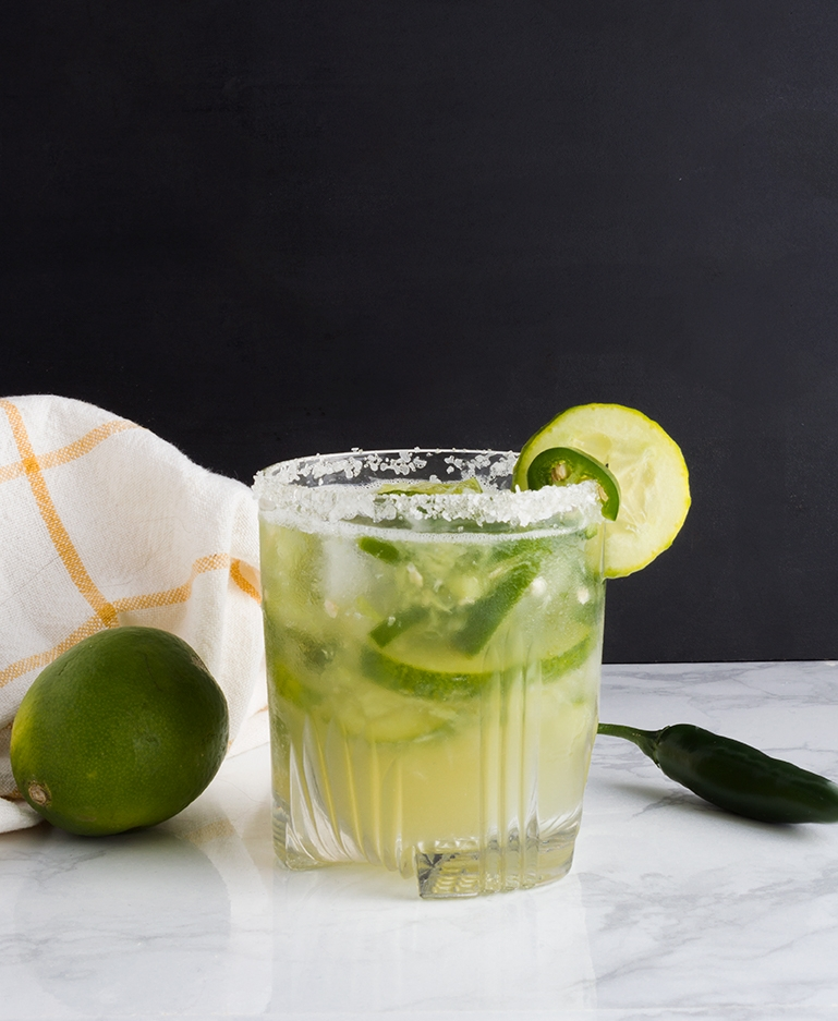These Cucumber Jalapeño Margaritas are just the right amount of spicy with a cool finish thanks to muddled cucumber.