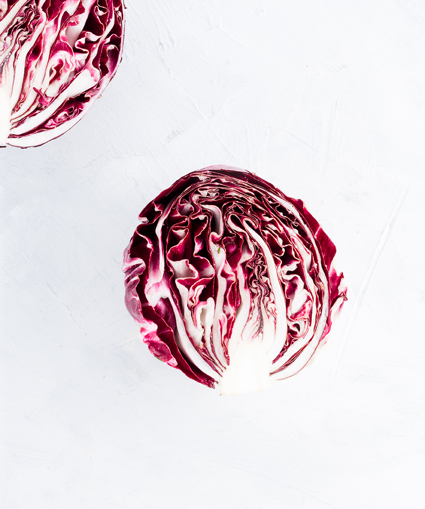 In the family of chicories, radicchio is a cool weather plant that has a bitter taste and bold, bright magenta leaves.