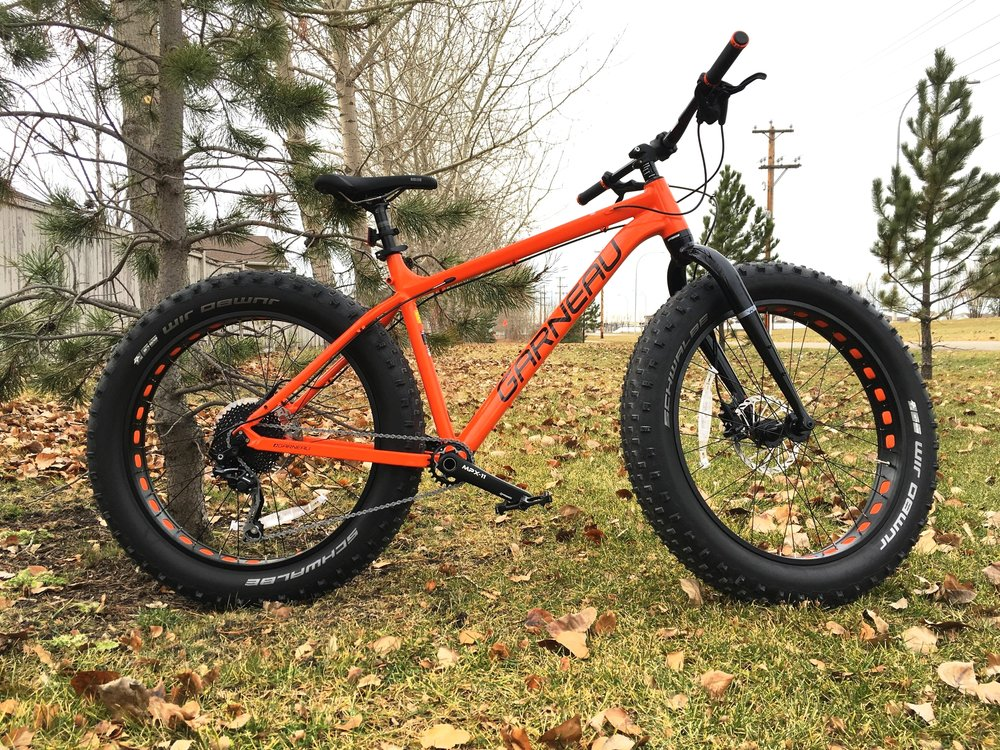 """GARNEAU GROS LOUIS 2. The only bike we trust for our rental program. One of the best valued fat bikes we've ever come across, tons of fun in the winter! 4.8"""" wide tires ensure a solid footprint and Avid hydraulic brakes keep you well under control"""