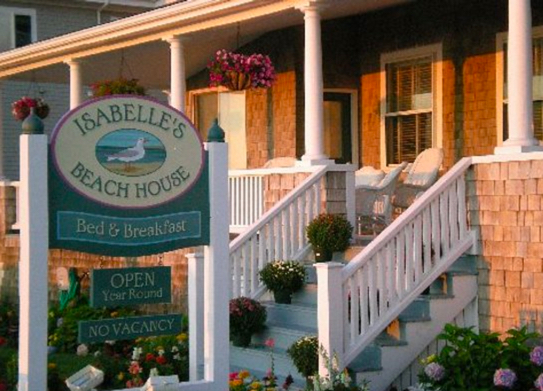 ISABELLE'S BEACH HOUSE (Oak Bluffs): 800-674-3129 CLICK HERE for availability or call for room rates Isabelle's Beach House is known for the panoramic ocean views from the sprawling front porch (as well as from some of their beach inspired guest rooms). Just minutes walking from the Martha's Vineyard ferries, Oak Bluffs harbor and downtown Oak Bluffs, this sea side inn offers the most convenient location to restaurants, art galleries, and great shopping Oak Bluffs Bus Shuttle:  .10 mile / Finish Line: 0