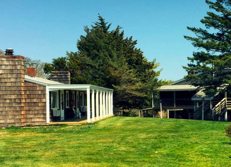 "ISLAND INN (Oak Bluffs):  800.462.0269 CLICK HERE to check availability or call for rates The Island Inn is a 51-room townhouse and condominium suite resort located in Oak Bluffs, MA. Our guests enjoy a centralized location steps from Martha's Vineyard's renowned beaches. We are a short walk along Beach Road to Joseph Silvia State Beach, and a 15 minute walk down Seawall Ave to the Oak Bluffs beaches, downtown Oak Bluffs, with its historic flying horses carousel and ""Gingerbread"" houses. Oak Bluffs Bus Shuttle:  1 mile / Finish Line: 1 mile"