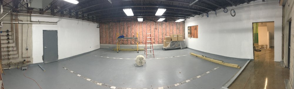 Picture of the brewing space just after the floors were finished.