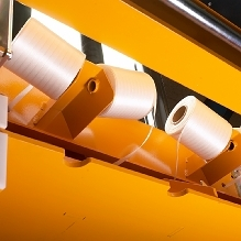 Strap rolls are easy to replace in front of the machine.