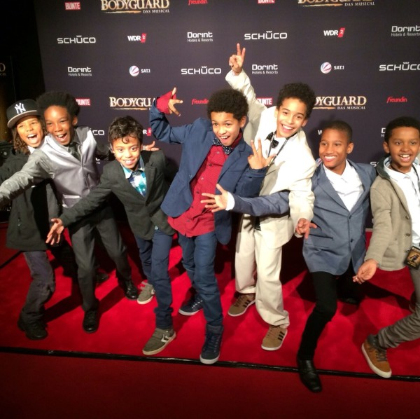 PHOTO: Seven boys who play Fletcher pose on the red carpet on the Opening Night of The Bodyguard Germany