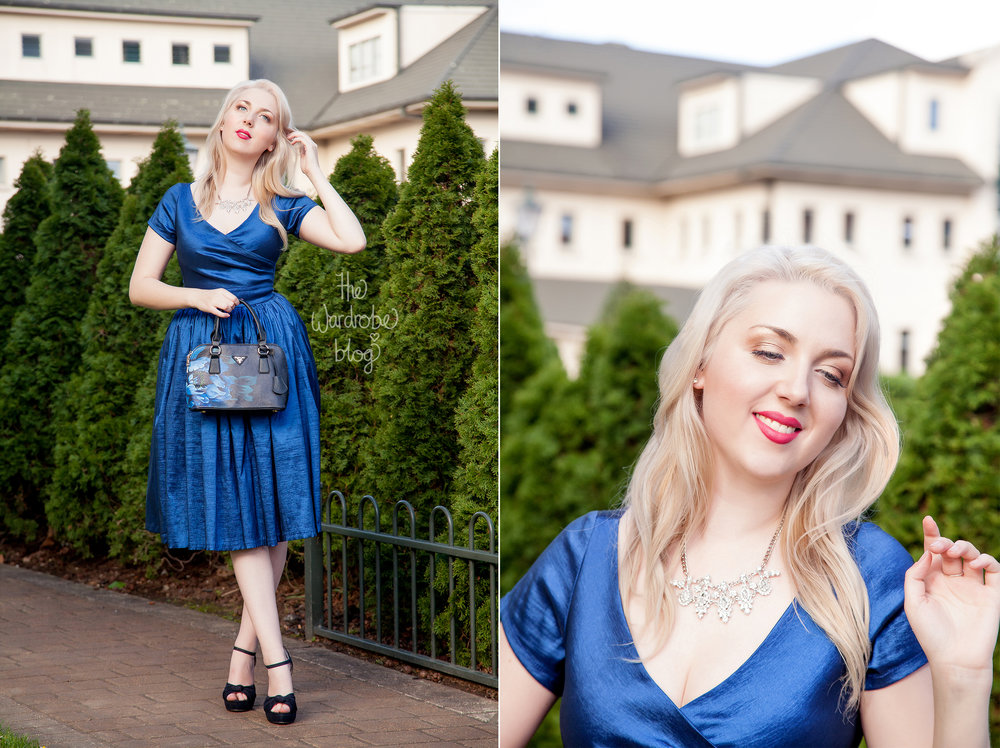 Ava Swing Dress in Dark Blue available at the Rita Sue Boutique, by Pinup Girl Clothing. Finon Milano Handbag with blue illustration from the Rita Sue Boutique. Necklace from Veronica B. Shoes from Novo Shoes.