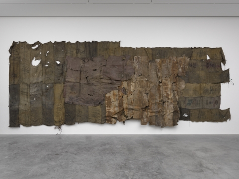 Ibrahim Mahama,  Gemtun Boxe , 2016, Old interior leather of scraped Henschel train on charcoal sacks. 177 3/16 x 440 9/16 in. (450 x 1119 cm). Photo: White Cube (George Darrell)