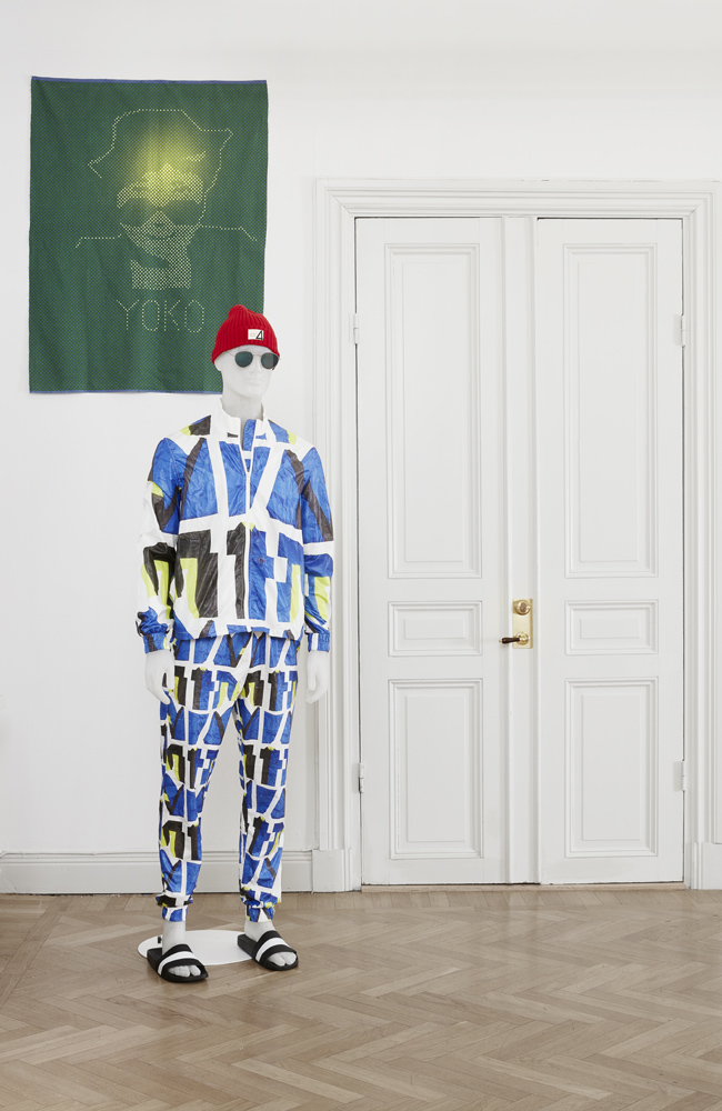 Cheryl Donegan   Artists and Models (Extra Layer tracksuit in Cut Up and Raster Star Yoko Ono)  2016 Nylon and cotton tracksuit, dyed cotton, mannequin Dimensions variable