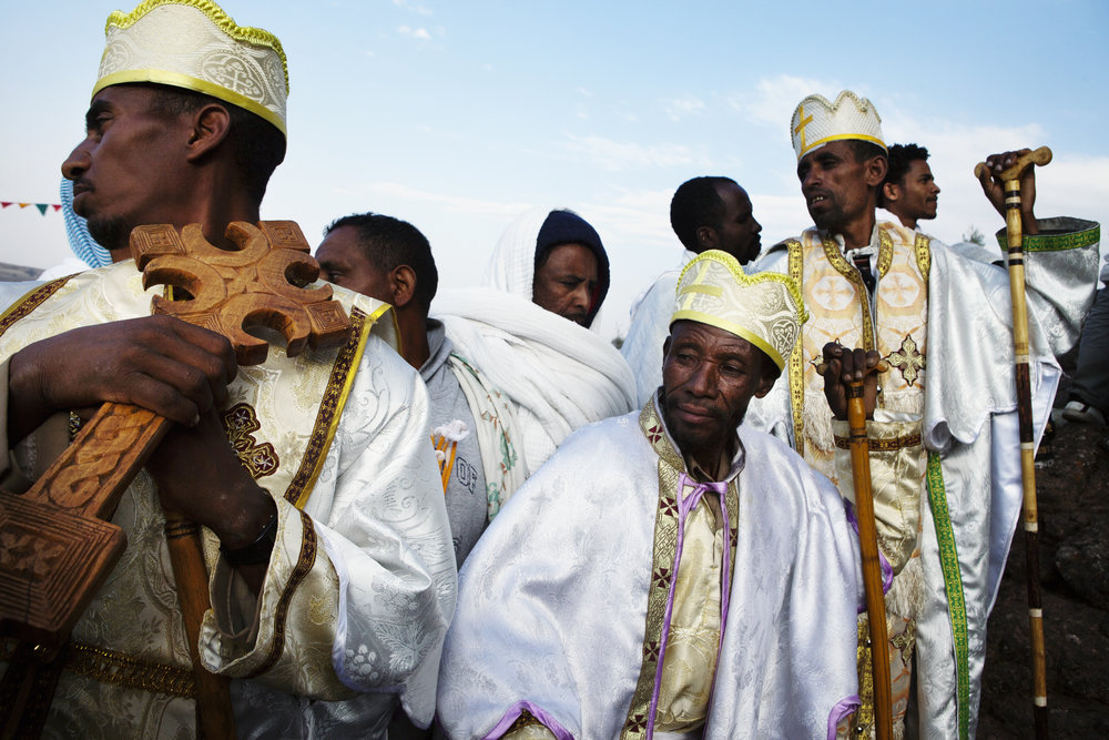Malin Fezehai   Priests on the wall surrounding the Saint Miriam church on Christmas day in Ethiopia  2016 C-print 43 x 65 cm