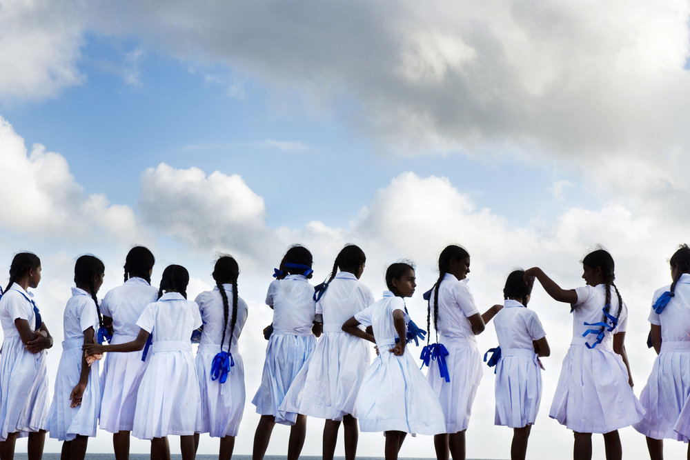 Malin Fezehai   School girls looking out to sea in Galle Port, Sri Lanka  2007 C-print 43 x 65 cm