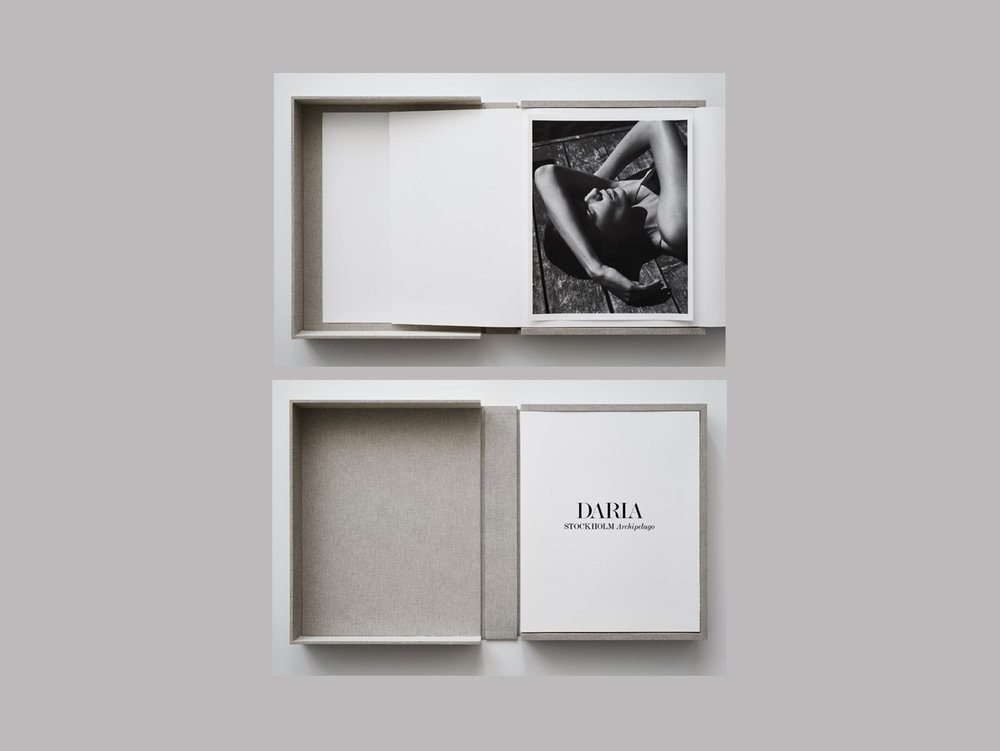 "Mikael Jansson   ""Daria Stockholm Archipelago"",   2018  Fabric-wrapped clamshell box with all 24 prints from ""Daria, The Archipelago series"" 45 x 55,88 x 6,5 cm  ""Ok, so back to my summers. Isn't it strange how your memories sometimes are much stronger than the real experience? These beautiful photos by the great Mikael Jansson remind me of this phenomenon. It's as if they embody a blessed moment that will never come back and therefore are so precious. I'm fascinated how well model and artist have worked together and you can tell both of them love nature and wild life. Of course, you want all the pictures and this beautiful box contains the complete series. Literally, summer in a box."""