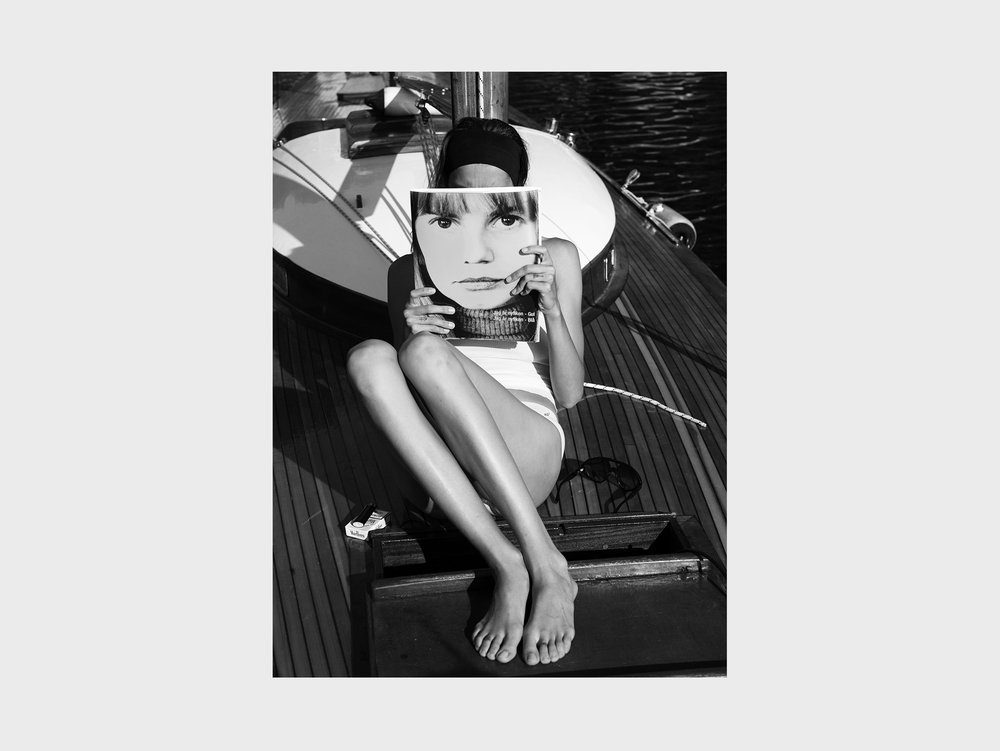 "Mikael Jansson    Daria, The Archipelago series # 24 , 2014 Silver gelatin mounted on aluminium Exclusively available in the collector box 50,8 x 40,6 cm Edition of 5 plus 2 AP  ""For most Swedes born before the 70s, Lena Nyman is an icon. She represents the shimmering and paradoxical era of innocence and political (left) movement. She had a longlasting career and many of us grieved when she passed away. It's her face on the cover of the magazine, most probably from the controversial film  I am curious  from 1967 that strongly contributed to the image of Sweden being a sexually openminded country. In Mikael Jansson's photo, it works as a journey in time."""