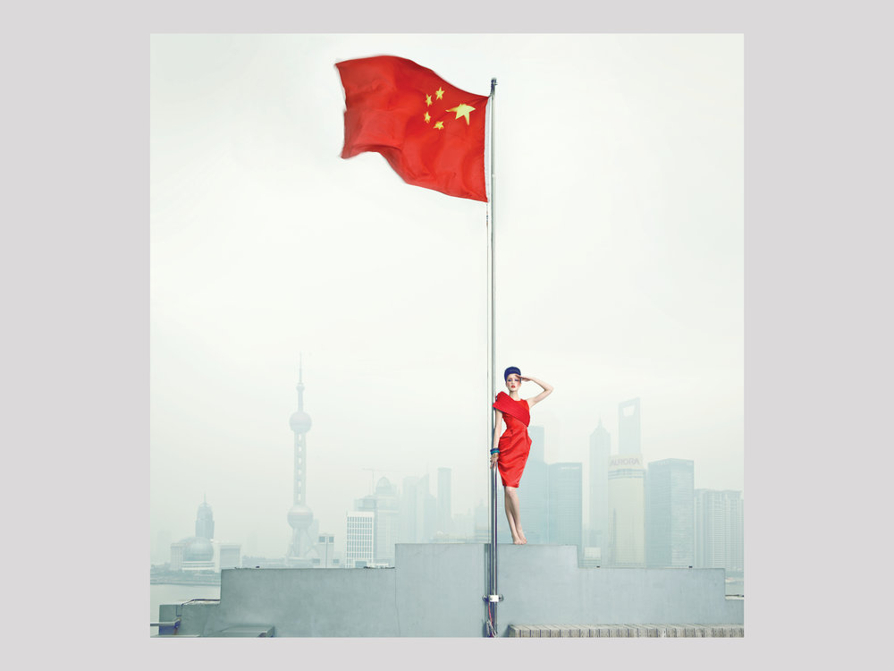 "Chen Man   Long live the Motherland. Shanghai  2010 Archival Pigment print 80 x 79 cm Edition of 15  Available   ""Chen Man (1980–), a celebrity in her own right in China, is now gaining international renown as a pioneer among China's fashion Photographers. Her vigorously retouched images incorporate several layers of narrative, and the current perception of China is interpreted and reinterpreted in the imagery she uses. In a country wracked by convulsions between the old and the new, she stages fusions between the past and the present, East and West, tradition and renewal, in order to question and reformulate norms and beauty ideals.Chen Man was born in the old quarters of Beijing, and grew up taking daily lessons in classical calligraphy and playing mah-jong with her grandmother at her bedside, a lifestyle that contrasted starkly with the new and modern city that was rapidly emerging just around the corner."""