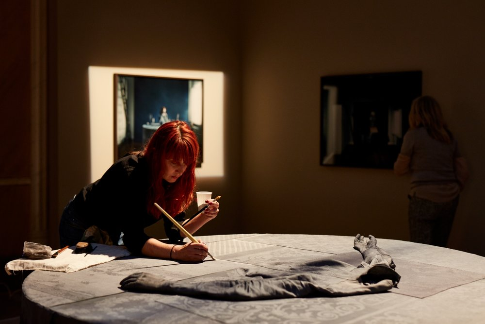 Photo: Emelie Janrell, tailor and designer, captured by Björn Petrén while working.