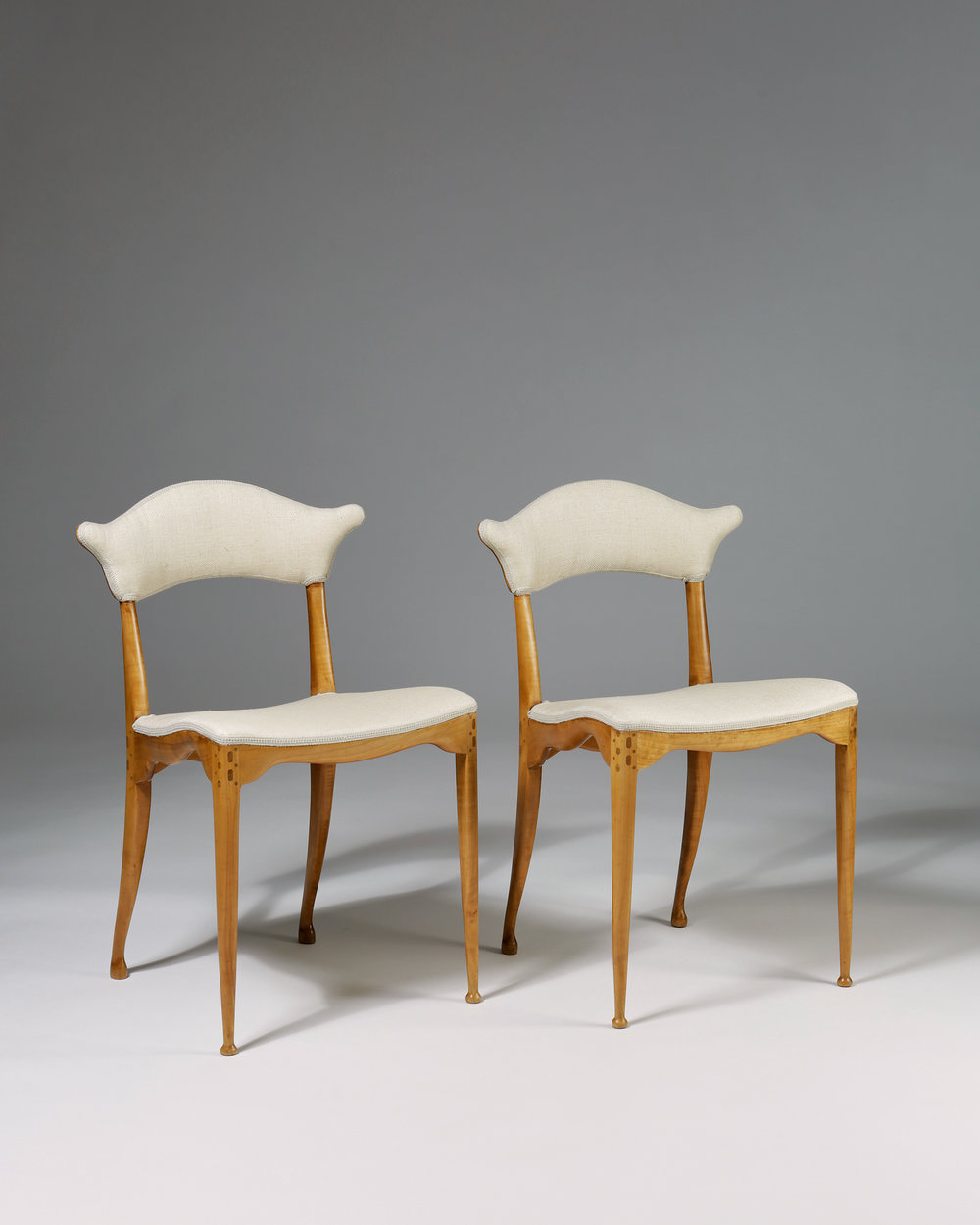 Peder Moos  Two pierced back chairs Denmark, 1949 Solid hand carved walnut with box wood inlays 80 x 50 x 52 cm Seat: 46 cm